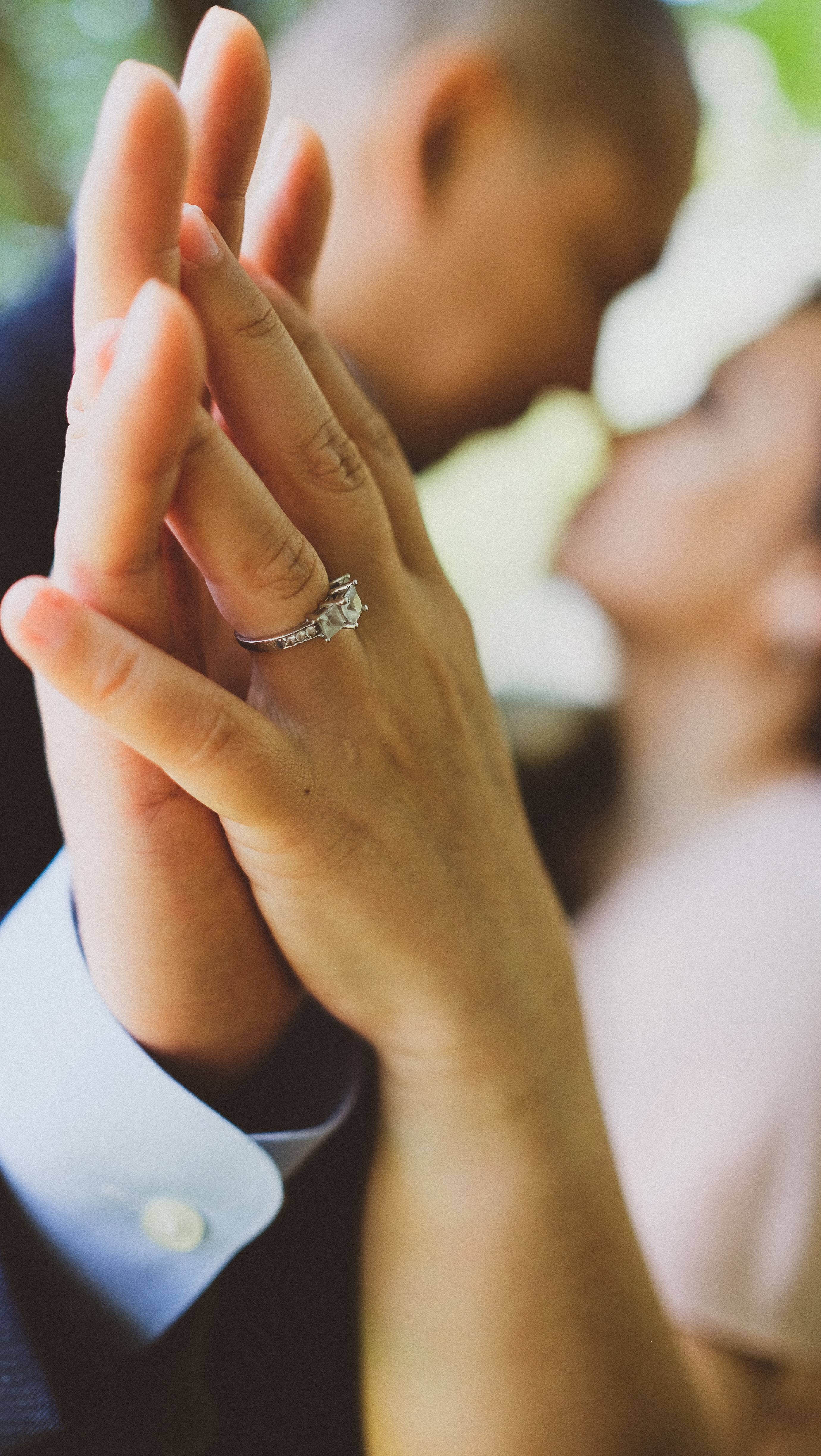 couple holding hands with antique diamond ring - Vintage Engagement Rings