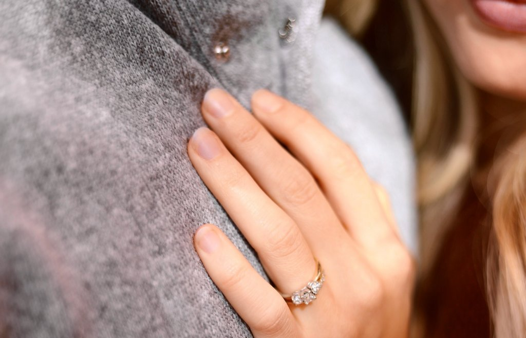 man and woman with a Three Stone diamond engagement ring - Three Stone Settings
