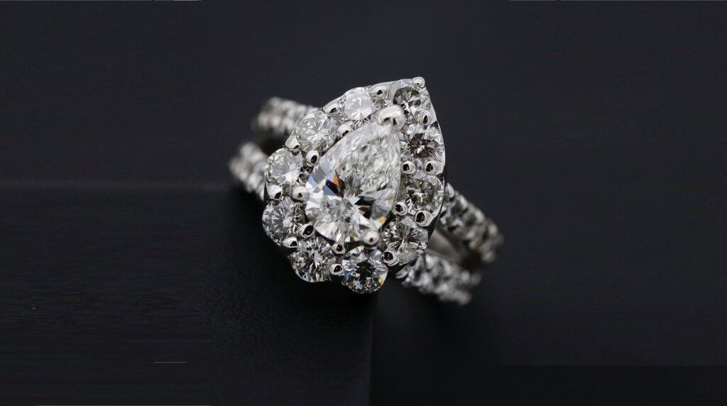 pear shaped diamond split shank round cut halo engagement ring - Understanding a Diamond's Symmetry Grade