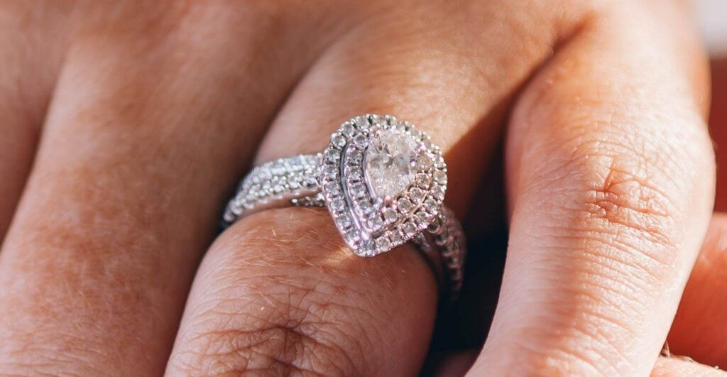pear shaped double halo engagement ring - Everything You Need to Know About F Color Diamonds.jpg
