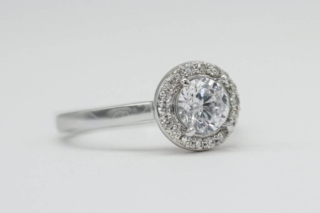 round halo diamond engagement ring hidden inclusion - What are Diamond Feathers