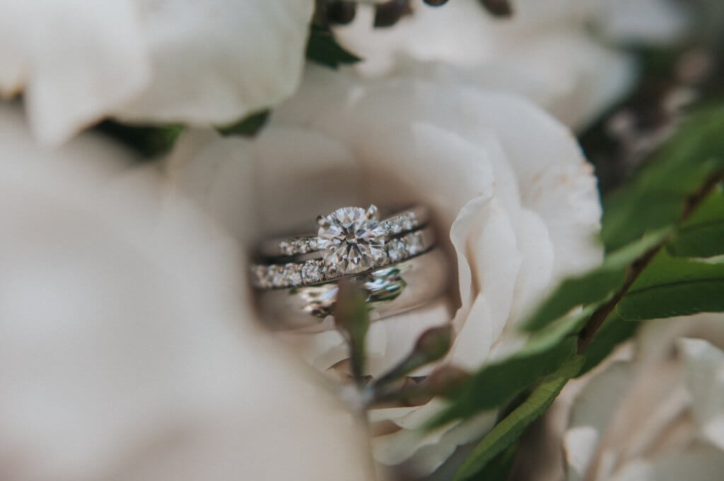 round solitaire pave engagement ring on diamond wedding band and a man wedding ring- Understanding a Diamond's Depth and Table